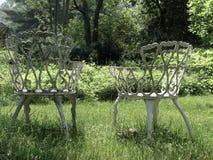 chairs lawntappning Arkivfoto