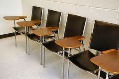 Chairs in lecture room. Chairs with table on armrest for taking notes during lectures Royalty Free Stock Photos