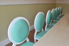 Chairs by length. Seven Chairs by length green Royalty Free Stock Image