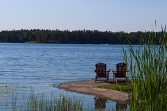 Chairs looking over beautiful lake view stock photos