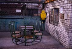 Chairs made of metal welded to each other at the forge plant. Resting place and smoking factory workers. Home-made manual seat assembly royalty free stock images
