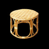 Chairs made of woven rattan on black Stock Photography