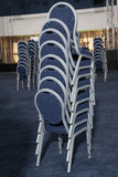 Chairs. Many restaurant chairs raised for cleaning Stock Images
