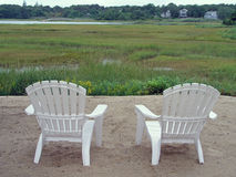 Chairs and marsh. Chairs overlooking a grassy area Stock Photos