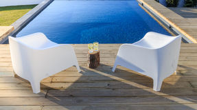 Chairs in modern house with wooden deck Stock Photo