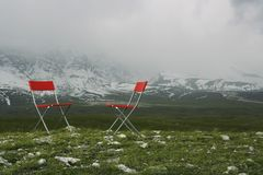 Chairs in Mountain Landscape Stock Images