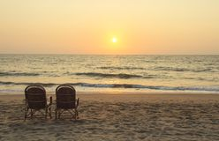 Chairs Near Coastline At Sunset Time Stock Image
