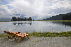 Chairs near a lake Stock Photography