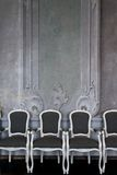 Chairs near wall Royalty Free Stock Photos