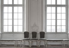 Chairs near wall Stock Photo