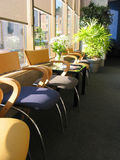 Chairs in office. Row of brightly colored chairs in a doctor's office on sunny morning royalty free stock photos