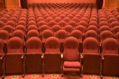 Chairs in an old cinema. Velvet chairs in an old cinema Royalty Free Stock Image