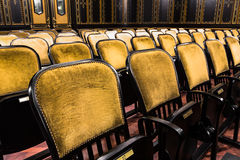 Chairs in an old theater. Wood chairs in an old theater Royalty Free Stock Images