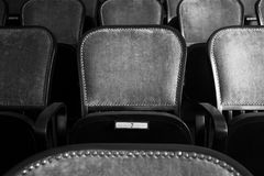 Chairs in an old theater. Wood chairs in an old theater, black and white Royalty Free Stock Photography