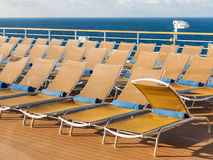 Chairs on outdoor deck on stern of cruise liner Stock Photos