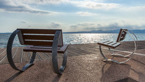 Chairs overlooking the lake garda Royalty Free Stock Images