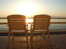 Chairs overlooking ocean Stock Photos