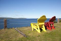 Chairs overlooking ocean Stock Photos