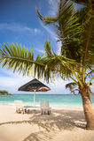 Chairs and parasol at tropical beach Stock Photos