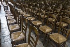 Chairs for parishioners in a catholic church. royalty free stock images
