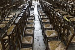 Chairs for parishioners in a catholic church. royalty free stock image