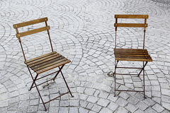 Chairs in the park. Two chairs in a square in a town of Portugal, Europe Stock Images