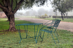 Chairs in park on overcast day Royalty Free Stock Photo