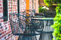 Chairs on a patio in the garden Royalty Free Stock Image