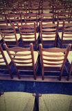Chairs in the place of worship before the religious ceremony wit. Background so many wooden chairs in the place of worship before the religious ceremony with Stock Photography