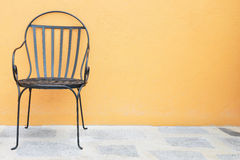 Chairs placed outside Stock Photos