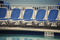 Chairs by the pool Stock Images