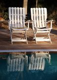Chairs and pool. Outdoor chairs near swimming pool royalty free stock images