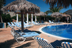 Chairs and Pool on a Cuba Resort. Eurostar Resort, Cayo Santa Maria, Cuba royalty free stock images