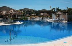 Chairs and Pool on a Cuba Resort. Eurostar Resort, Cayo Santa Maria, Cuba Royalty Free Stock Photo