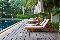 Chairs on a pool deck Royalty Free Stock Images