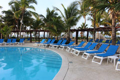 Chairs and Pool on a Mexico Resort. Barcelo Maya Colonial Resort, Riviera Maya stock photo