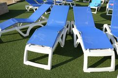 Chairs at poolside Royalty Free Stock Photography