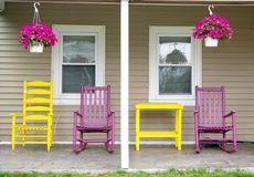 Chairs on the porch. Chairs sitting on a porch at a summer home Stock Photos