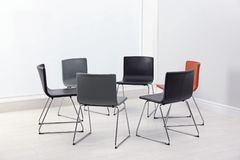 Chairs prepared for group therapy session in office. Meeting room interior royalty free stock photo