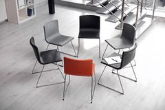 Chairs prepared for group therapy session in office. Meeting room interior stock photo