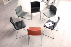 Chairs prepared for group therapy session in office. Meeting room interior royalty free stock images