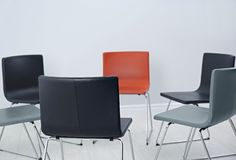 Chairs prepared for group therapy session in office. Meeting room interior royalty free stock photography