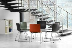Chairs prepared for group therapy session in office. Meeting room interior stock image