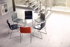 Chairs prepared for group therapy session in office. Meeting room interior stock photos