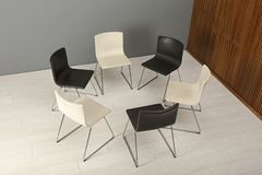 Chairs prepared for group therapy session in office. Meeting room interior stock images