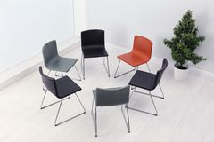 Chairs prepared for group therapy session in office. Meeting room interior royalty free stock image