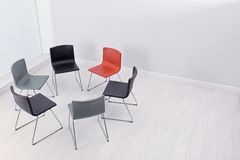 Chairs prepared for group therapy session in office, space for text. Meeting room interior stock photos