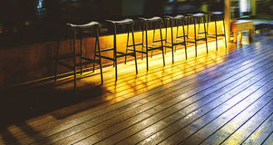 Chairs at a rack in an empty bar Royalty Free Stock Image