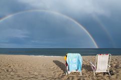 Rainbow on the beach in the summer. Chairs and rainbow in Old Orchard Beach in Maine, USA Stock Images