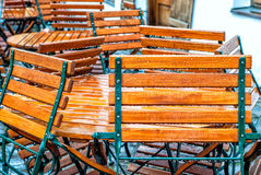 Chairs with raindrops. Wooden chairs with raindrops round a table Stock Photos